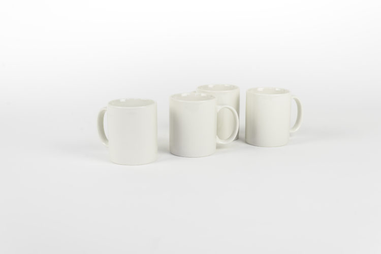 photo of 4 white mugs